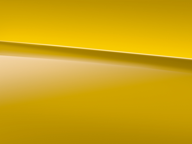 Vue de trois quarts de profil de la Mercedes CLA avec la peinture Standard jaune soleil