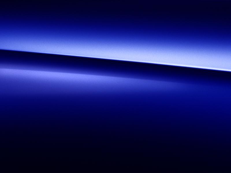 Vue de trois quarts de profil de la Mercedes-Benz GLS avec la peinture Métallisé - Bleu brillant