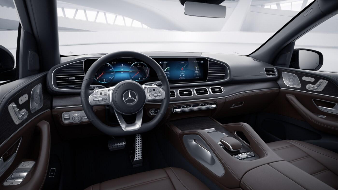 Poste de conduite de la Mercedes GLS AMG Line avec vue sur l'écran tactile, sellerie et console centrale