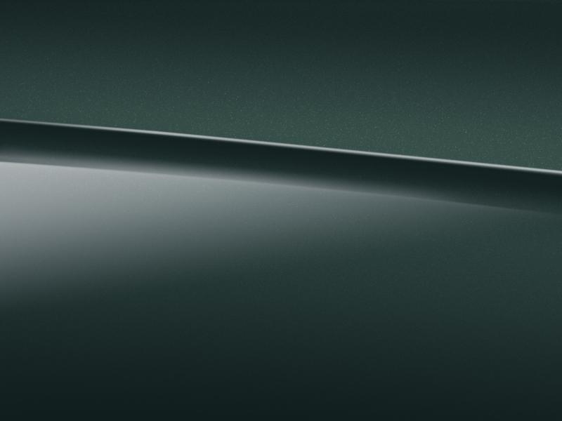 Vue de trois quarts de profil de la Mercedes-Benz classe G avec la peinture métallisé - vert périclase métallisé G manufaktur