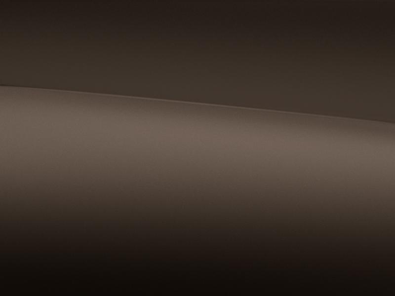 Vue de trois quarts de profil de la Mercedes-Benz classe G avec la Peinture magno - Marron citrine magno G manufaktur