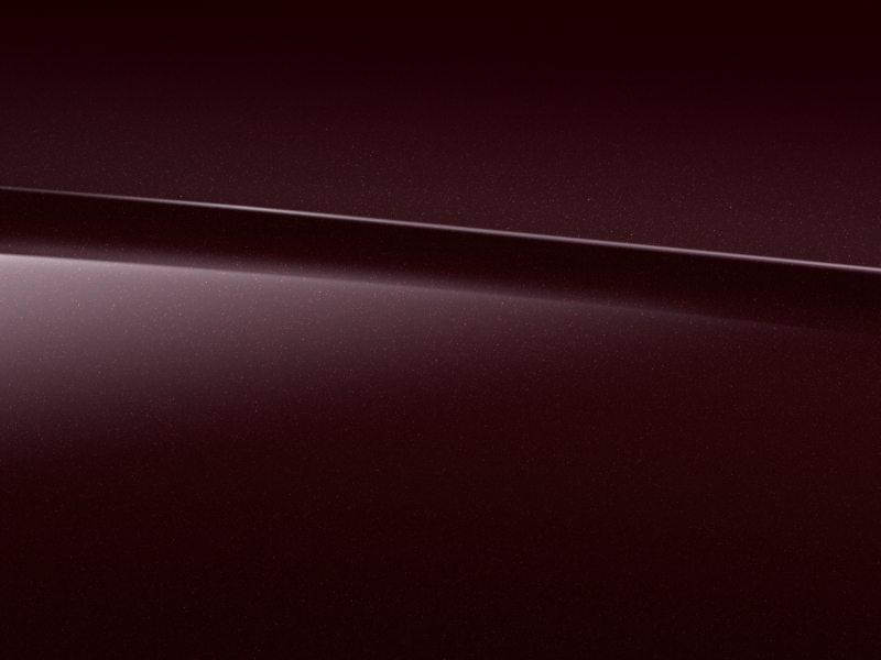 Vue de trois quarts de profil de la Mercedes-Benz Classe G avec la peinture Métallisé - Rouge Rubellite