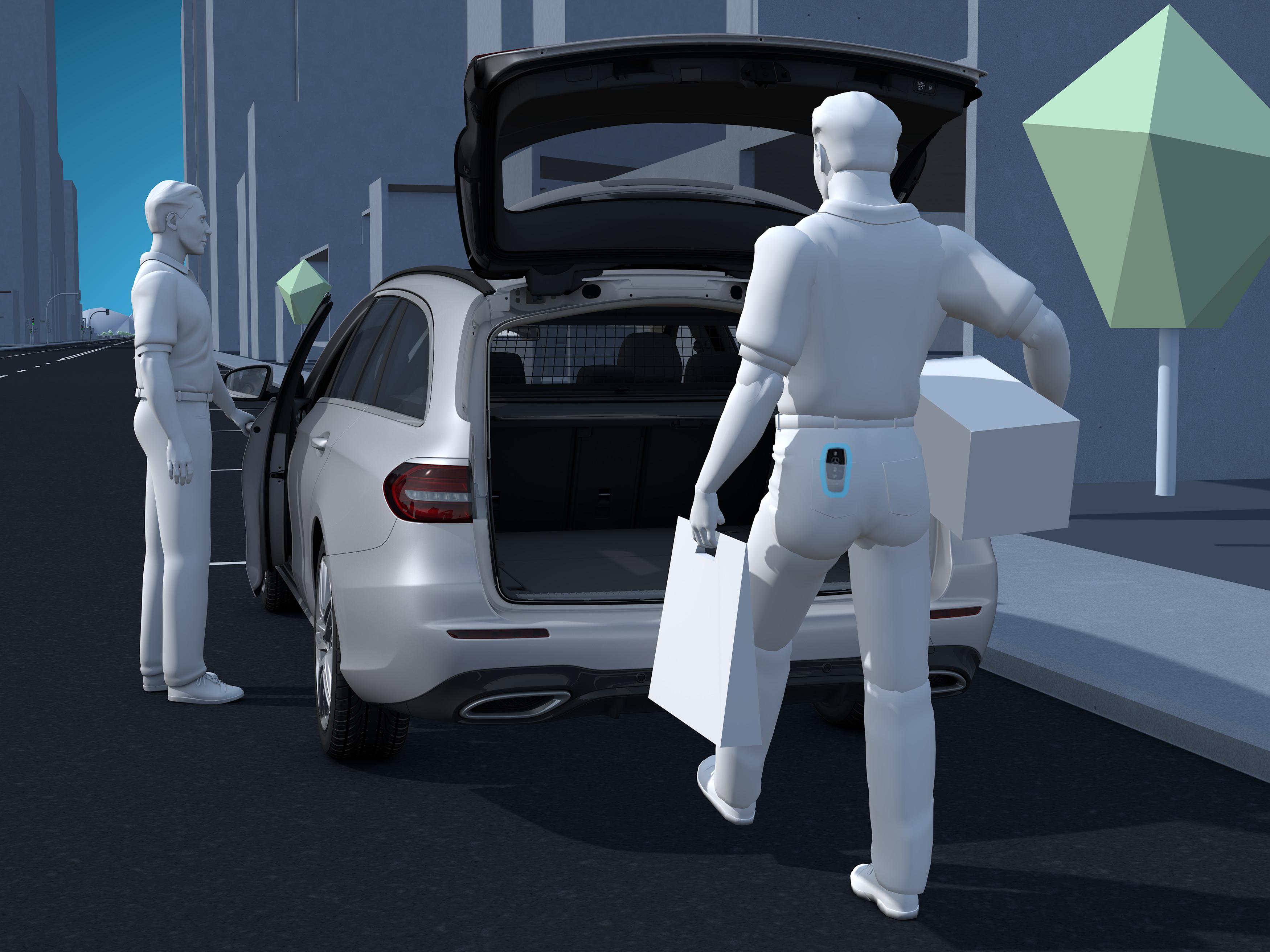 Une personne ouvre automatiquement le coffre de la Mercedes GLE AMG Line plus â l'aide des détecteurs de mouvements
