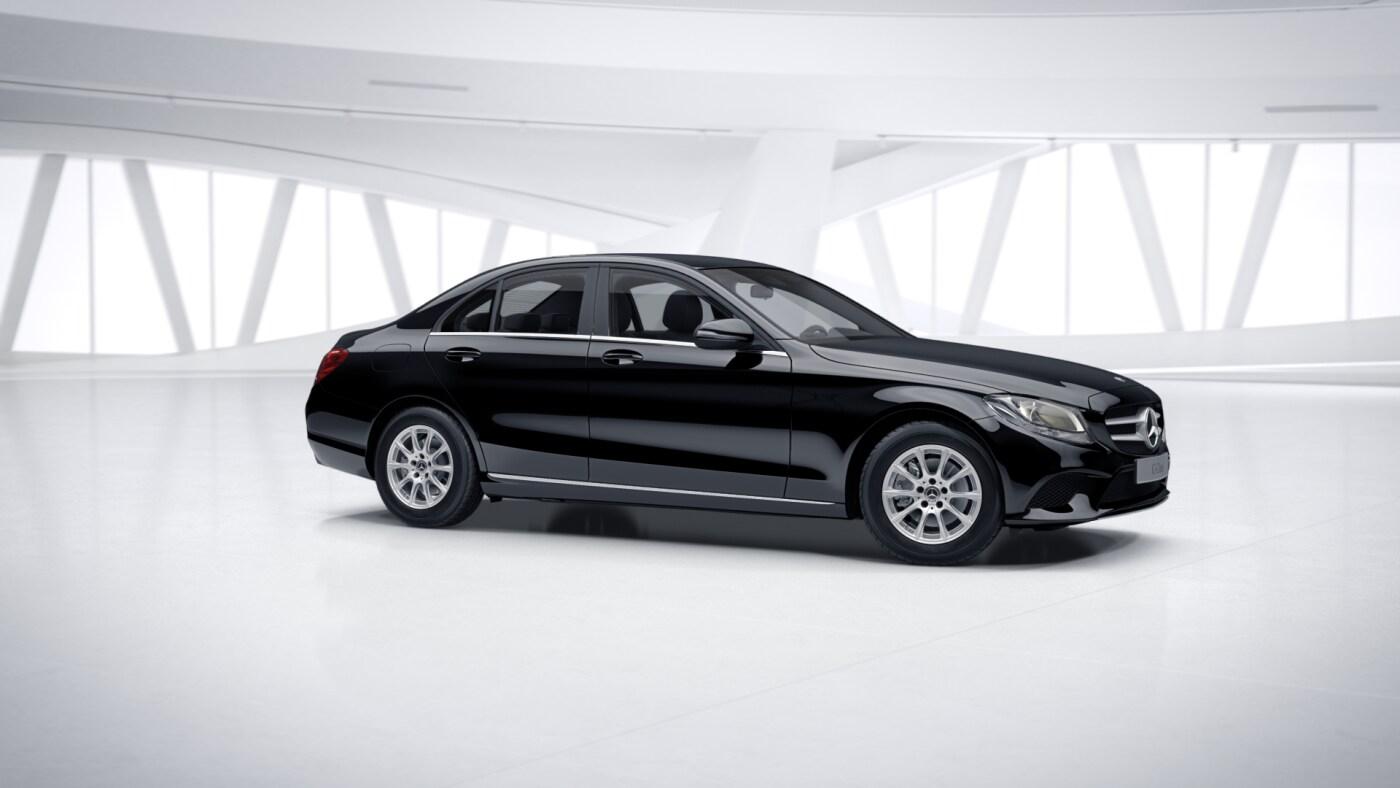 Mercedes Benz Classe C Berline noire Finition Business : Vue de trois quarts de profil à l'arrêt