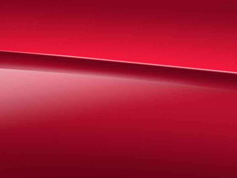 Vue de trois quarts de profil de la Mercedes-Benz GLA avec une peinture designo - rouge Patagonie Métallisé