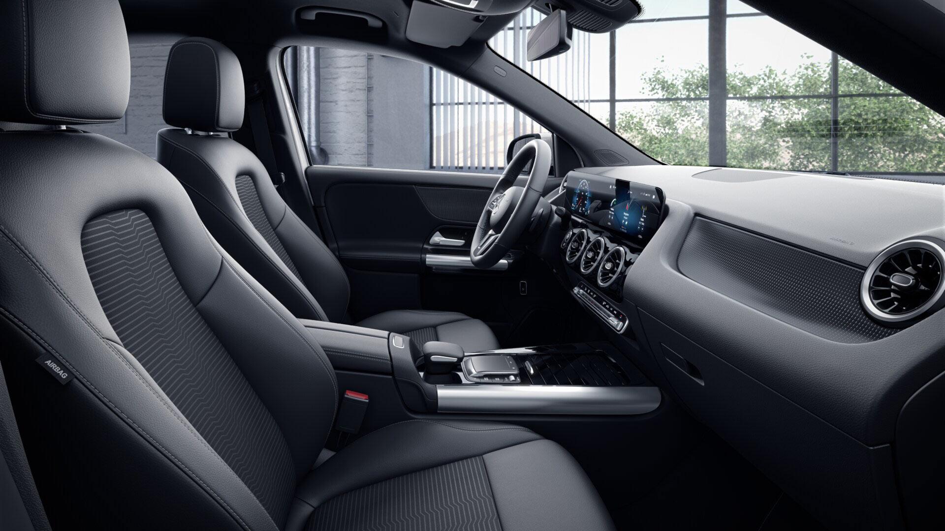 Poste de conduite de la Mercedes GLA avec vue sur l'écran tactile, sellerie et la console centrale