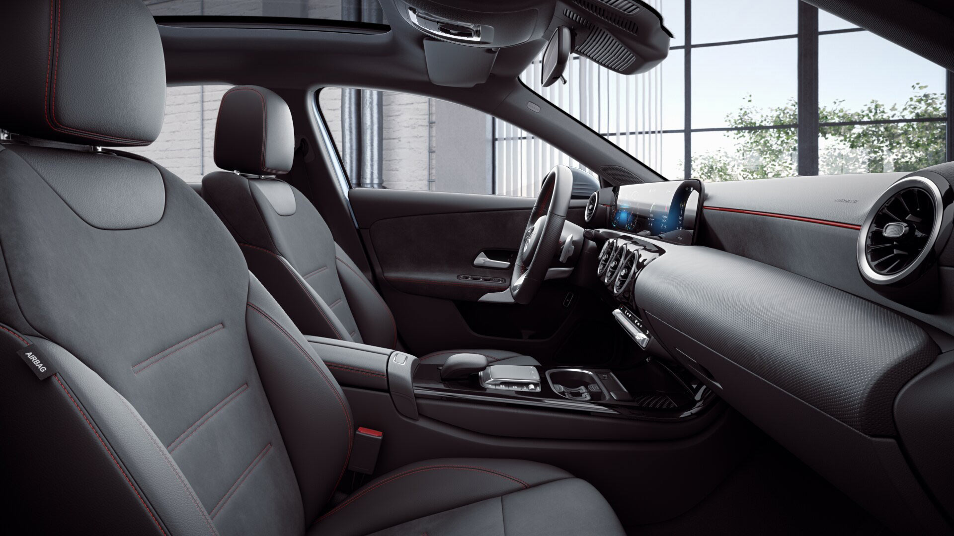 Poste de conduite de la Mercedes Classe A berline avec vue sur les écrans tactiles, sellerie et la console centrale - Finition AMG Line